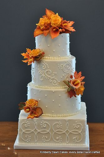 Simple white fall wedding cake with floral accents -