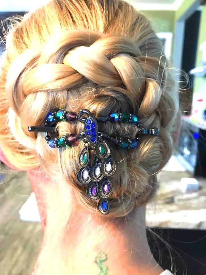 Stunning Peacock Flexi Hair Clip In A Beautiful Braided Bun