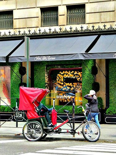 Tricycle cab, outside Saks Fifth Avenue, 611 Fifth Avenue, New York City. May 30, 2015.