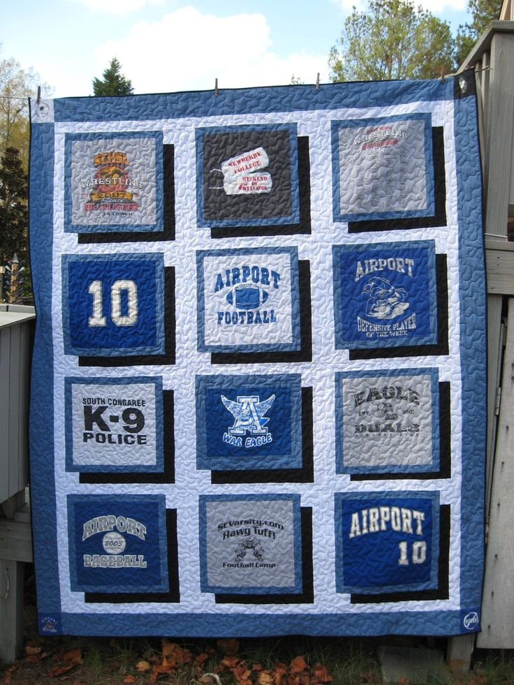 T-shirt quilt for Renee.  Large stipple quilting.