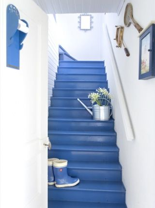 colourful basement stairs - white walls