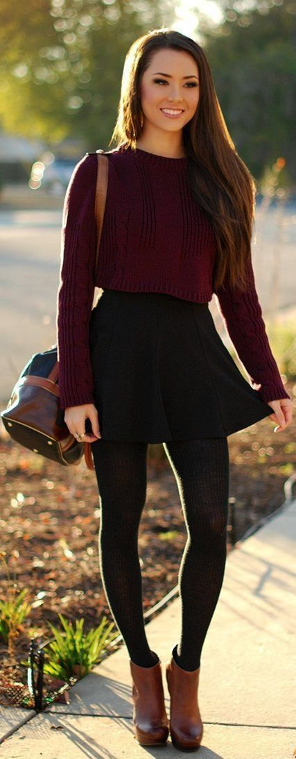 Women's Burgundy Cropped Sweater, Black Skater Skirt, Brown Leather Ankle Boots, Dark Brown Leather Cross body Bag.
