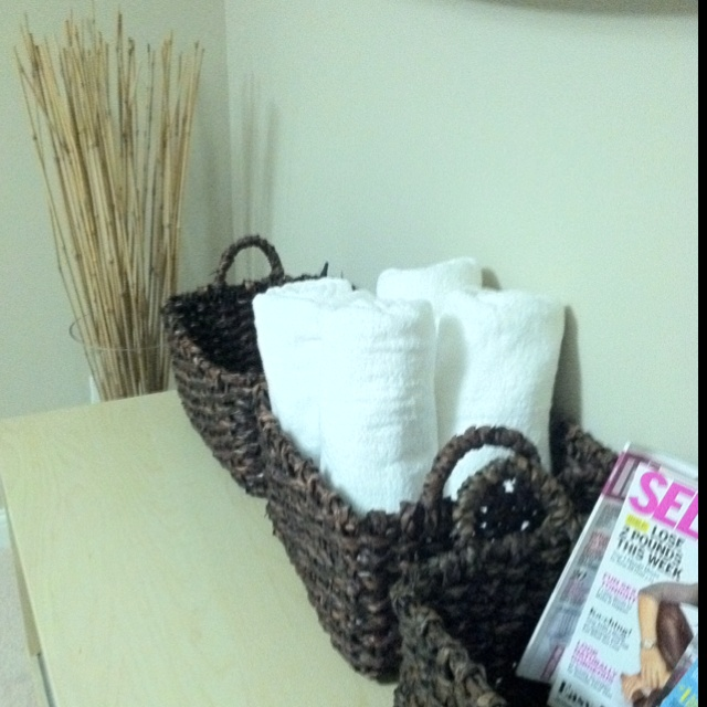 Home Gym Decor, baskets for towels and magazines...I'm