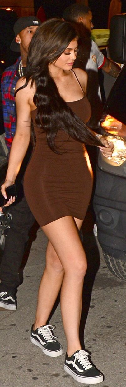 Who made  Kylie Jenner's brown mini dress and black sneakers?