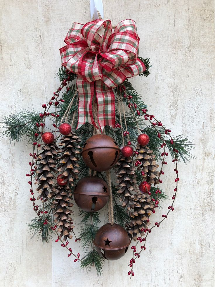 A personal favorite from my Etsy shop https://www.etsy.com/listing/560226502/christmas-door-swag-holiday-front-door