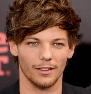 Oh no! #OneDirection's Louis Tomlinson has to cancel soccer debut with Doncaster Rovers