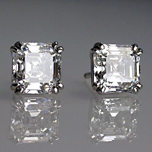Matching asscher cut diamond earrings in platinum.