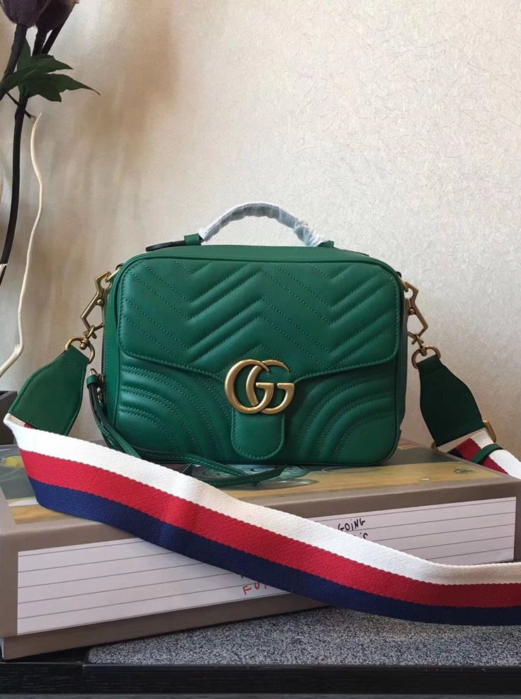8f140a409d1f Gucci GG Marmont small Green shoulder bag has a top handle with a 2 inches  drop and a shoulder strap with 19.5 inches drop. All are made of leather  and both ...