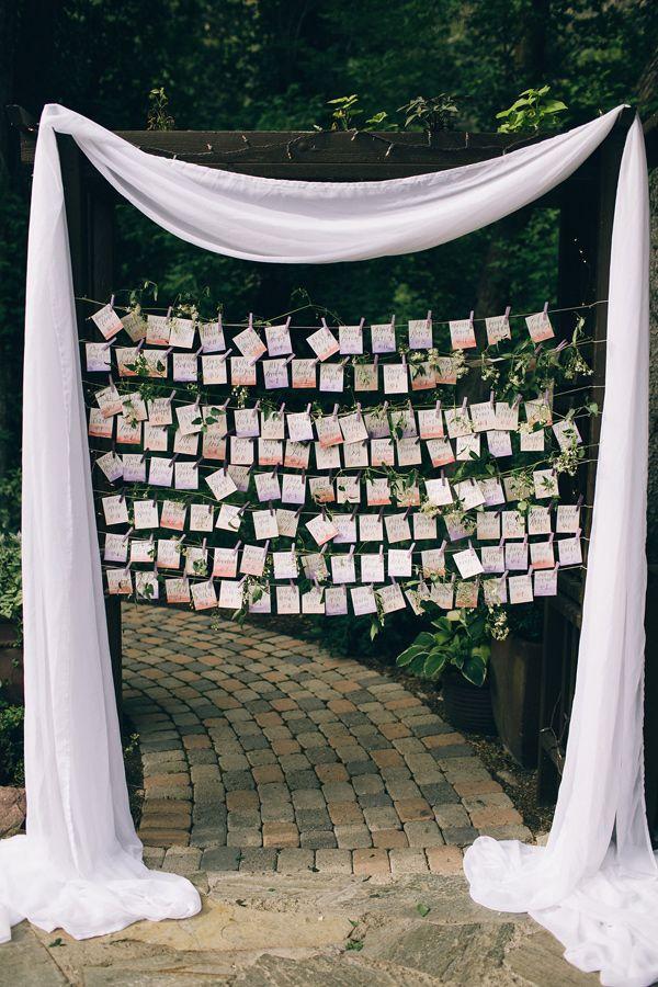 seating chart display - photo by Jessica Janae Photography http://ruffledblog.com/romantic-forest-wedding