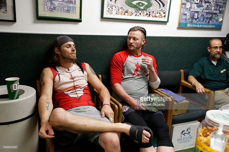 My favourites! Josh & Josh! Josh Reddick #22 of the Oakland Athletics and Josh Donaldson #20 of the Toronto Blue Jays relax in the Athletics clubhouse prior to the game at the Oakland Coliseum on July 15, 2016 in Oakland, California. The Athletics defeated the Blue Jays 8-7.