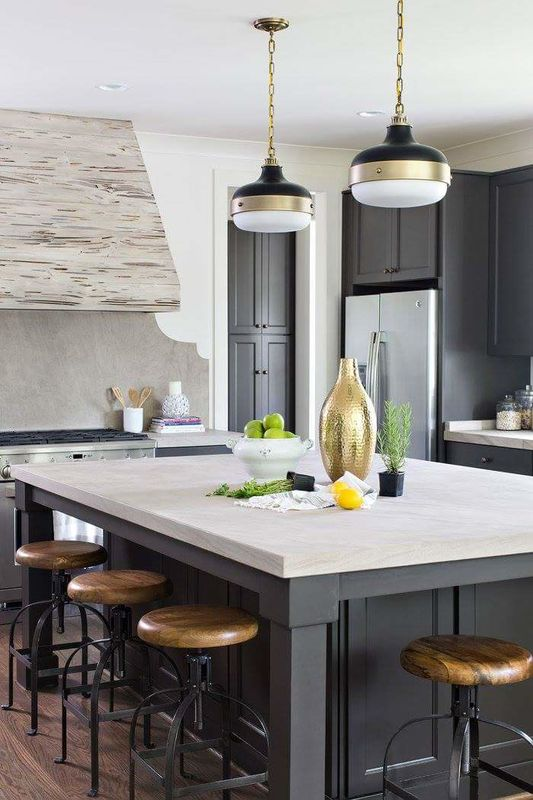 dark painted cabinets with limestone countertops fiess lighting jessica conner design u0026 interiors