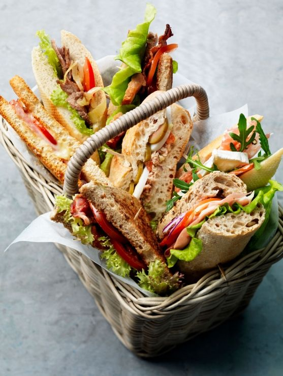 basket of wonderful sandwiches... great for a picnic... someone bring the wine