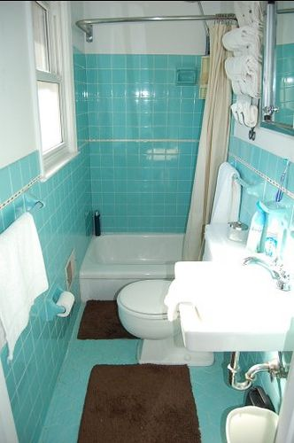 Small 1964 aqua tile bathroom ~ shows use of small space for studio bathroom.  I like the small receptor square tub. This is the type of bathroom that would be gutted, expanded and filled with beige everything on a home improvement show.  I like it just the way it is!