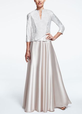 A classic and demure look that is ideal for any mother of the bride or groom!  Features 3/4 sleeve wrap mock jacket with dazzling broach.  Long charmeuse skirt gives this dress a whimsical feel.  Fully lined. Back zip. Imported polyester. Dry clean only.