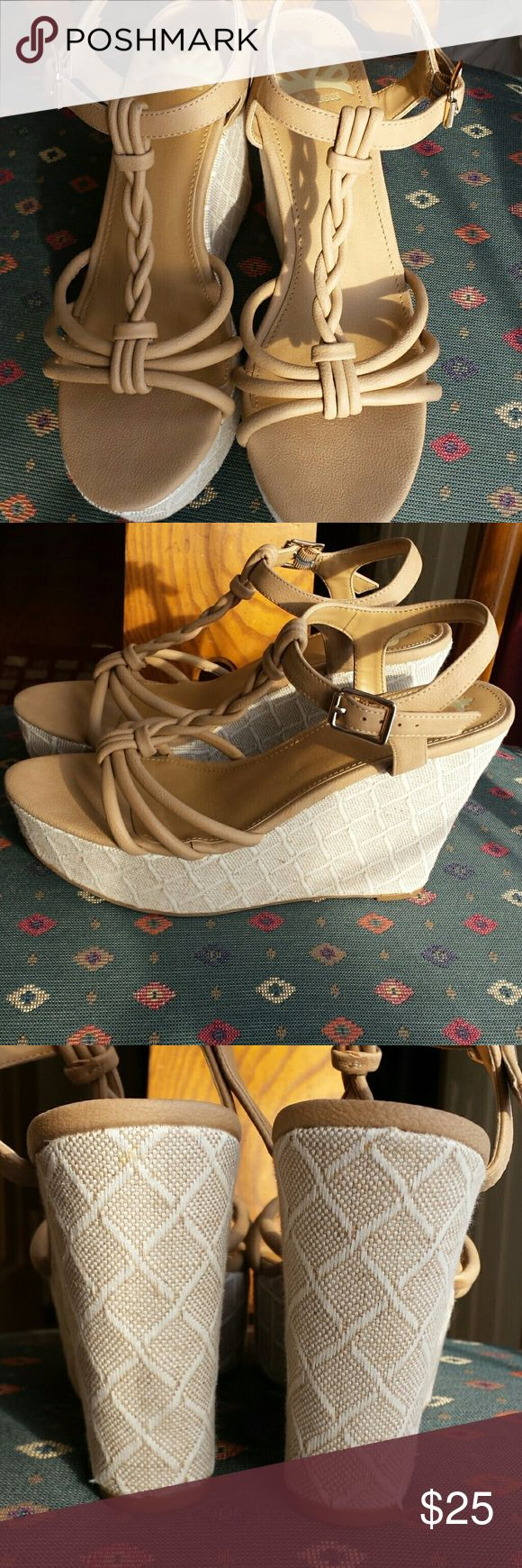 Very Pretty Fergalicious by Fergie Sandals These sandals are in like new condition. very nice 4 inch wedge heels.  2 inch platform. Tan in color. Fergalicious by Fergie Shoes Sandals
