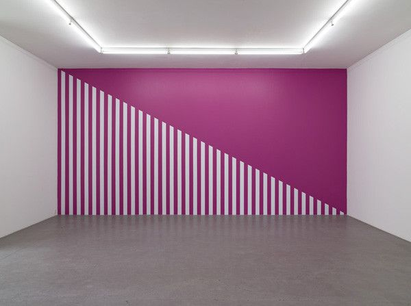 Daniel Buren. A Diagonal for a Rhodamine Red wall (2006): work in situ Galleri Nicolai Wallner Copenhagen. July 2006. Paint and acrylic on wall. Installation size 327 x 625 cm.