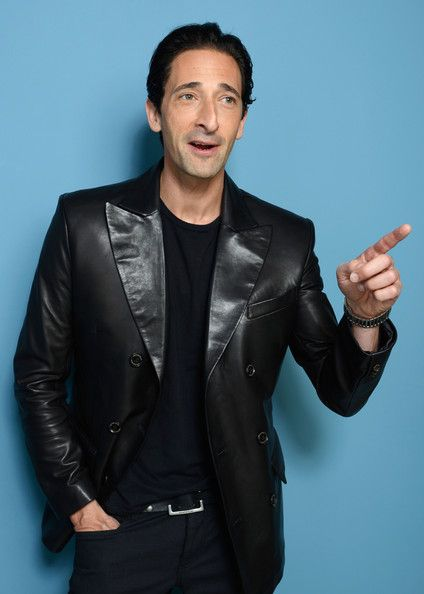 Adrien Brody Photos - Actor Adrien Brody of 'Third Person' poses at the Guess Portrait Studio during 2013 Toronto International Film Festival on September 10, 2013 in Toronto, Canada. - Maria Bello Poses in Toronto