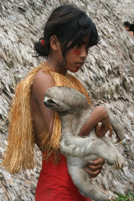 A child with a pet sloth
