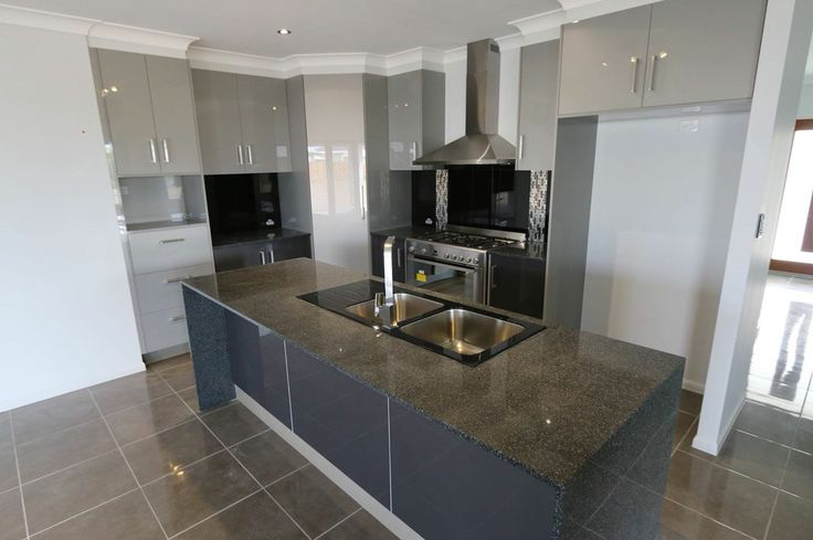 G.J. Gardner Kitchen with High Gloss Stylite Cupboards and 20mm Modular Granite Benchtops