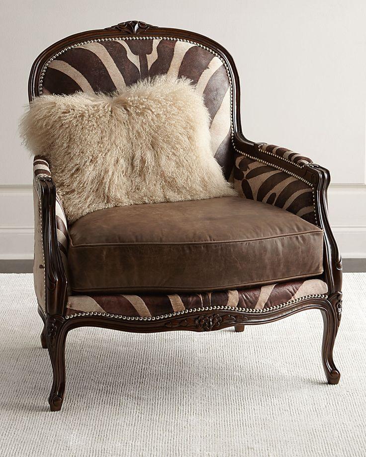"Handcrafted bergere chair. Hardwood frame. Leather upholstery. 35""W x 36""D x 41""T. Seat, 26""W x 19""D x 20""T; arms, 26""T. Decorative pillow made of Tibetan sheepskin (USA). Nailhead trim. Dovetailed jo"