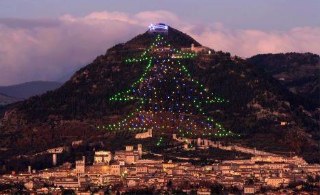 'World's biggest' Xmas tree lights up Italian town - The Local