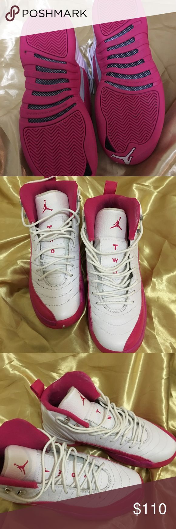Pink and white Jordans Has little to no creases , worn a few times , has little lint balls from my socks on the inside of it and they're in good condition. Jordan Shoes Sneakers