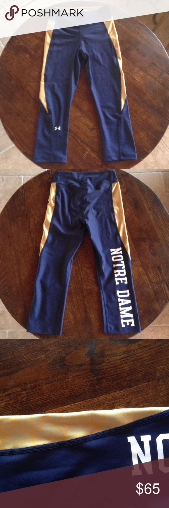 BRAND NEW EXCLUSIVE Notre Dame leggings Exclusive brand new, Notre Dame, three quarter length leggings- cannot be bought in store or online; navy blue and gold Under Armour Pants Leggings