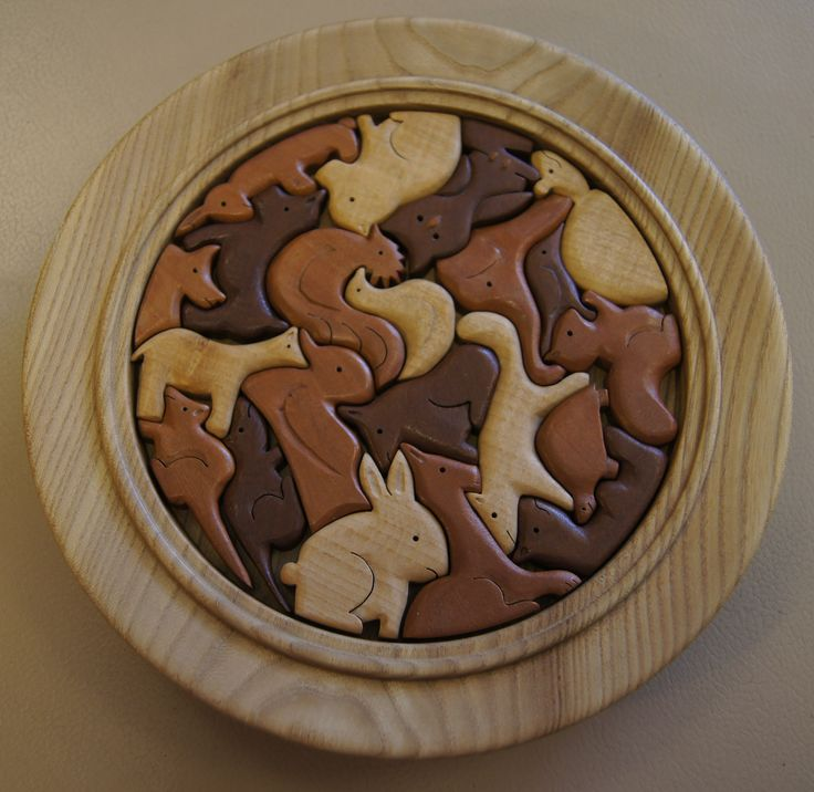 East Yorkshire wood turner made this, love the movement of the composition and the way the animals feel whilst one is trying to place them in the puzzle.