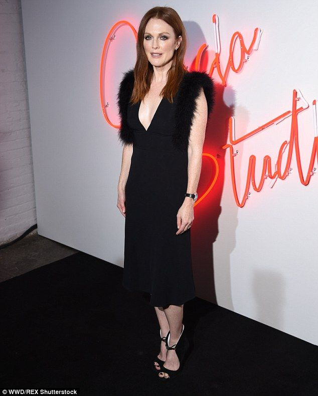 Daring around the décolletage: Julianne Moore was both sexy and elegant in a low-cut black dress at the premiere of the short film Ferragamo Signature in NYC on Tuesday