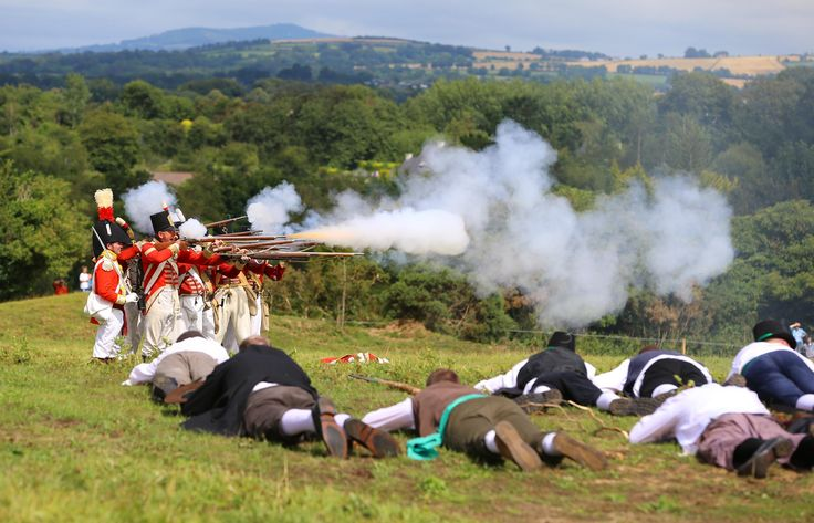 Fallen Rebels beneath a Redcoat Volley at the annual Vinegar Hill Battle Re-enactment, Enniscorthy, Co. Wexford, August Bank Holiday Weekend.