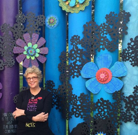 Carol stands inside her ArtPrize 2014 entry titled Color Out the Darkness. She has met thousands of people from all around the world at this popular art competition here in Grand Rapids, MI. Read more about it at coloroutthedarkness.com