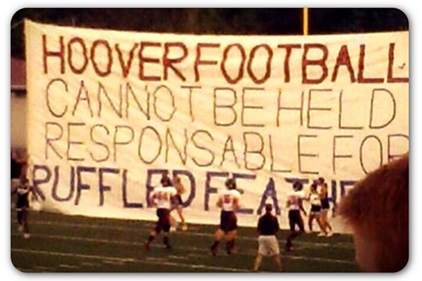 High school football team bursts through misspelled sign | Articles | Home