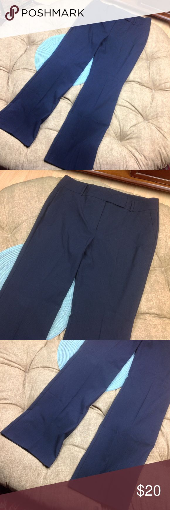 Ann Taylor Dress Pants 12 Women Signature Blue Great Condition; Ann Taylor Dress Pants 12 Women Signature Dark Blue Pockets Straight Trouser; 32 inch inseam 17.5 inch across waist 11.5 inch rise 63/35/2 Polyester/Rayon/Spandex Ann Taylor Pants Trousers