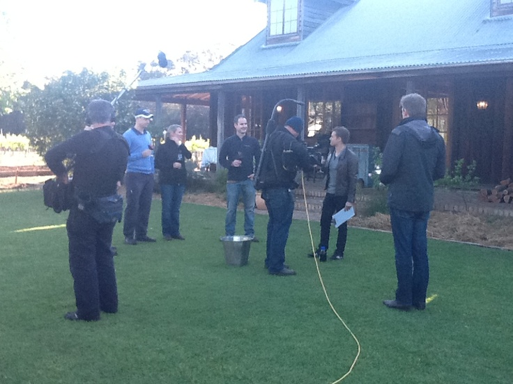 Grant & the winemakers in a wine spitting challenge!