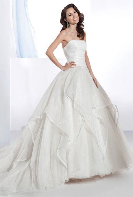Brides: Demetrios - Illusions. Organza, strapless gown with a ruched bodice, full A-line soft tulle skirt with handkerchief organza overlay, and chapel length train. Available in white and ivory.