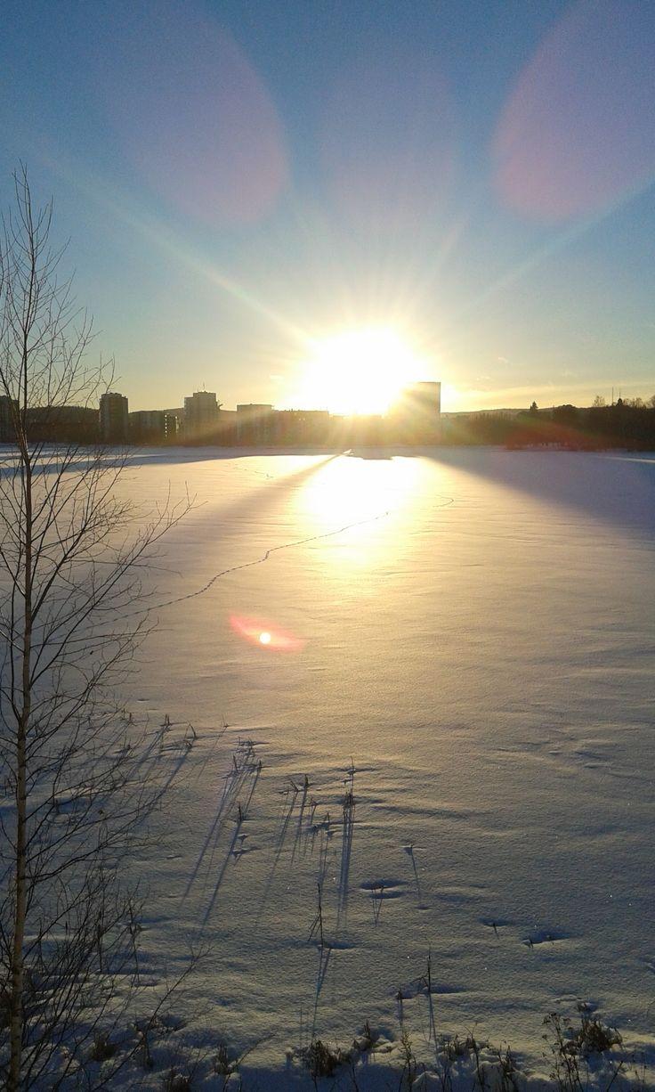 Sunset behind the lake in Jyväskylä, Finland.