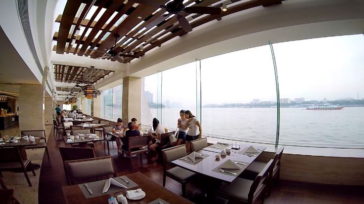 One of the restaurants in the White Swan Hotel in Guangzhou, China where we ate.  It is right on the Pearl River at almost water level.  The River Cafe Restaurant. We were there on the adoption trip when we adopted Da Yan Zi in August, 2000.