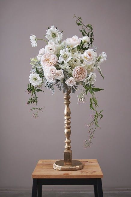 candlestick arrangement  http://www.brittanymakes.com/2013/09/04/diy-wedding-decor-gold-candlestick-centerpieces/