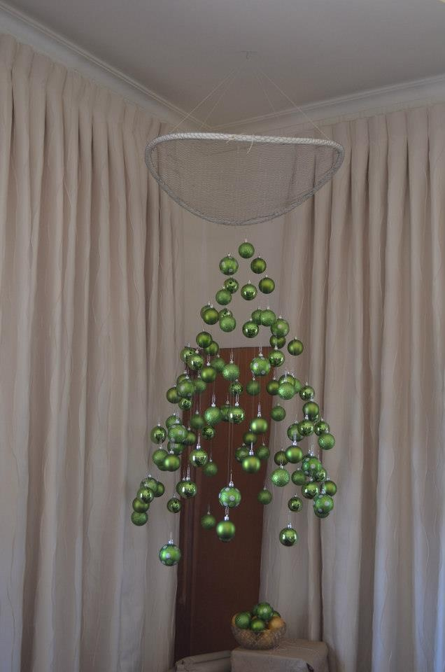 Hanging christmas baubles in the shape of a christmas tree
