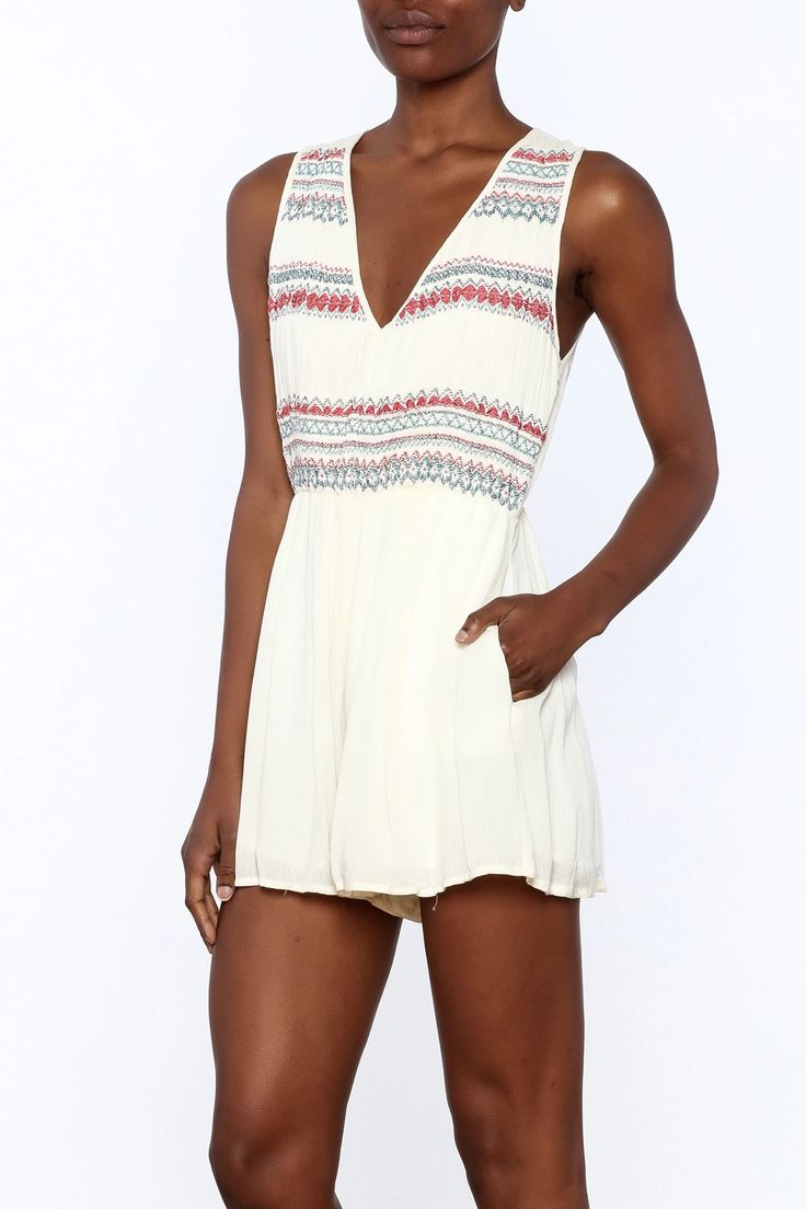 Sleeveless white romper with embroidery on the waist, side pockets, v-neckline and a zipper closure.   Sleeveless Embroidered Romper by Lush. Clothing - Jumpsuits & Rompers - Rompers Manhattan, New York City New York City