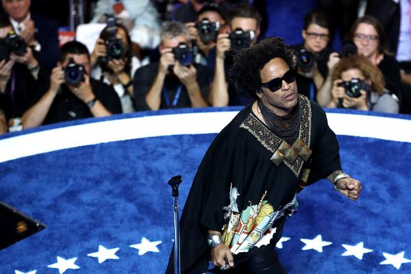 Lenny Kravitz Photos Photos - Recording artist Lenny Kravitz performs during the evening session on the third day of the Democratic National Convention at the Wells Fargo Center, July 27, 2016 in Philadelphia, Pennsylvania. Democratic presidential candidate Hillary Clinton received the number of votes needed to secure the party's nomination. An estimated 50,000 people are expected in Philadelphia, including hundreds of protesters and members of the media. The four-day Democratic National…
