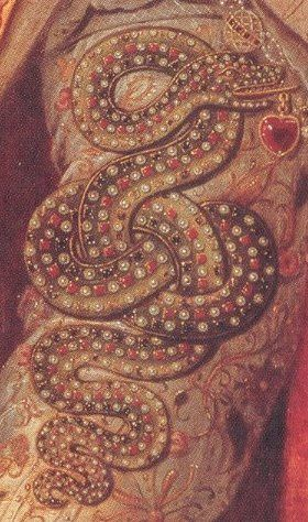 Detail of a serpent embroidered on Elizabeth's sleeve in the Rainbow Portrait, with a heart-shaped ruby in its mouth. The serpent represents wisdom, and the ruby Elizabeth's heart, implying that the Queen's wisdom controls her emotions.