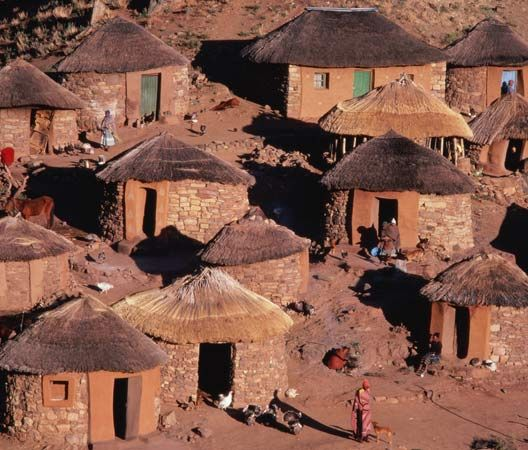 Circular huts are the traditional houses of the Sotho people of Lesotho. (Nicholas DeVore—Stone/Getty Images)