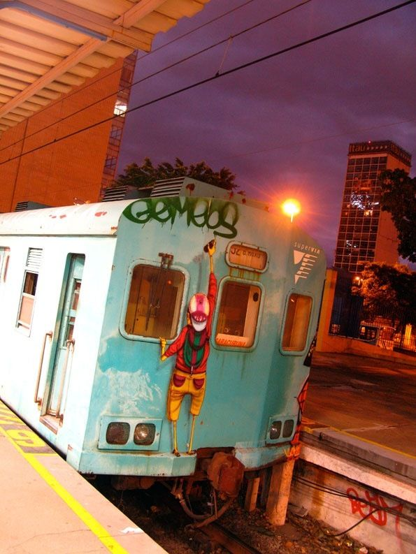 Great one on the back of a train by Os Gemeos