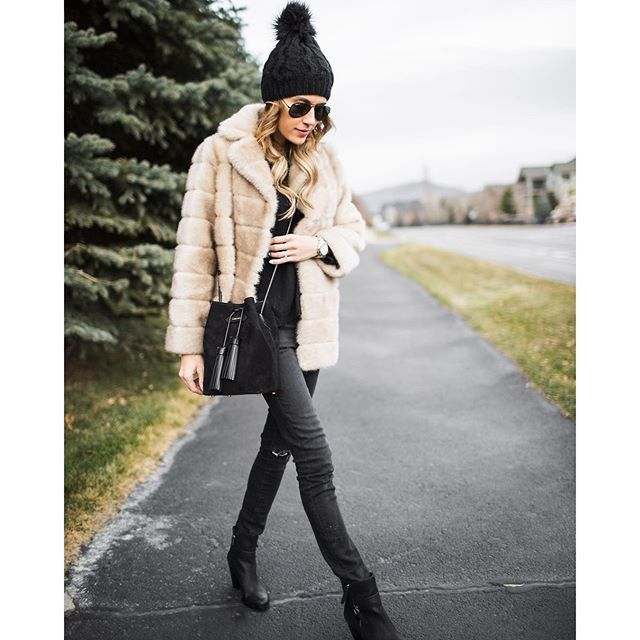 A faux-fur jacket, a beanie, and boots