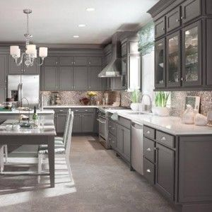 gray kitchen. not sure about the knobs