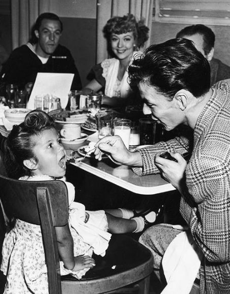 Frank Sinatra Feeding Daughter Nancy as Gene Kelly & Pamela Britton watch on the set of Anchors Aweigh ...