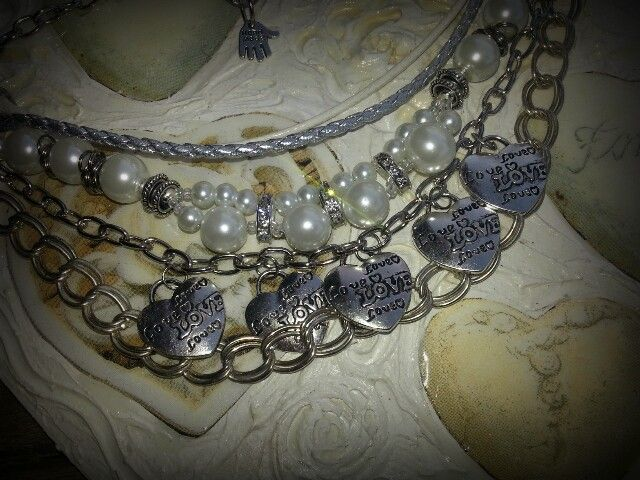 Pearl and silver charm necklace by Caren