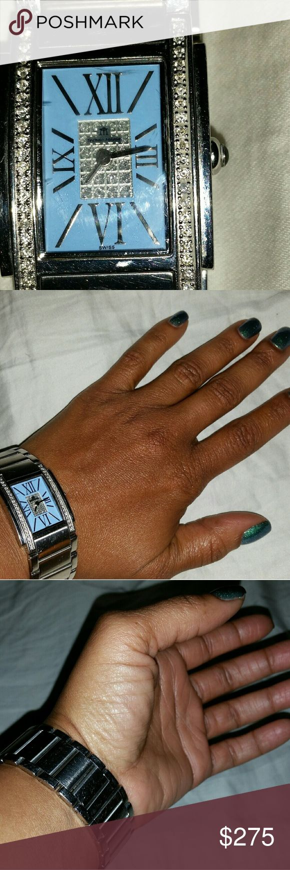100% Authentic Techno Mania Ladies Diamond Watch Techno Mania Watch, Stainless Steel with Genuine Diamonds. Turquoise face with Roman Numerals. I love this watch,  but time for an upgrade. Other than some normal wear and tear, like scratches, and the clasp needs to be tightened,watch is in good condition . This is an expensive watch,  ladies and worth it. Technomarine Accessories Watches