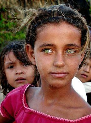 Brazilian girl with piercingly beautiful green eyes